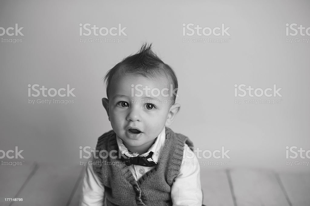 Serious Baby Sitting With Mohawk royalty-free stock photo