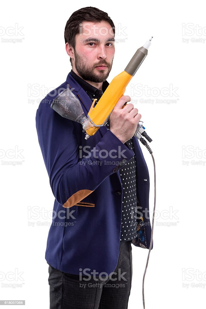 Serious bearded man with powder gun stock photo