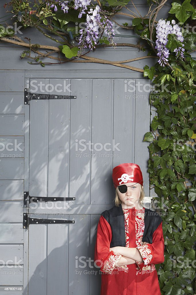 Serious Boy In Pirate Costume By Shed stock photo