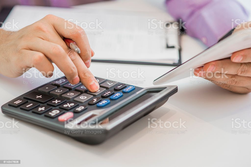 Serious business man working on documents looking concentrated stock photo