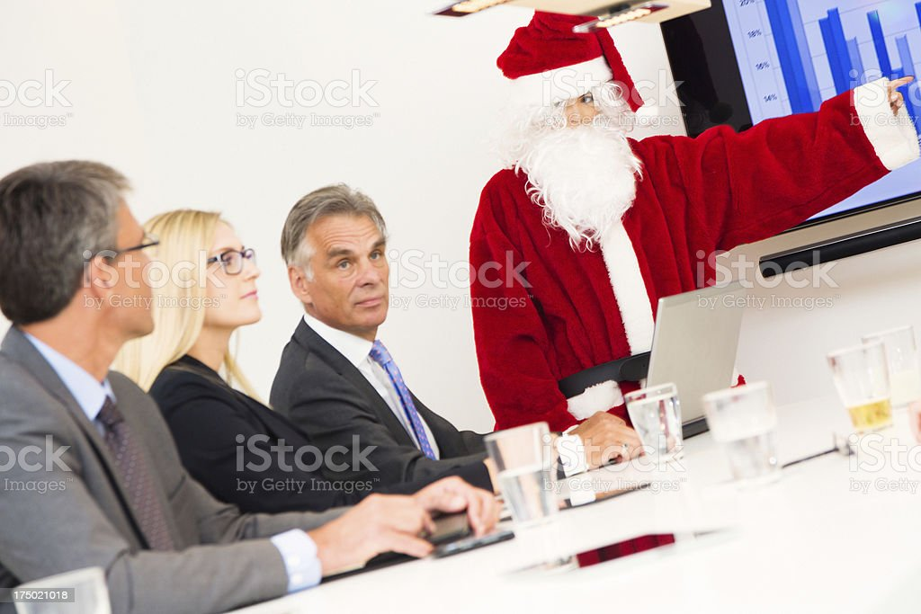 serious business team having a conference with santa stock photo