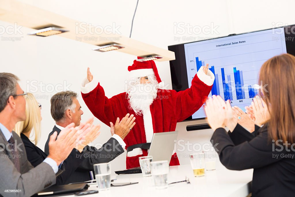 serious business team having a conference with santa royalty-free stock photo