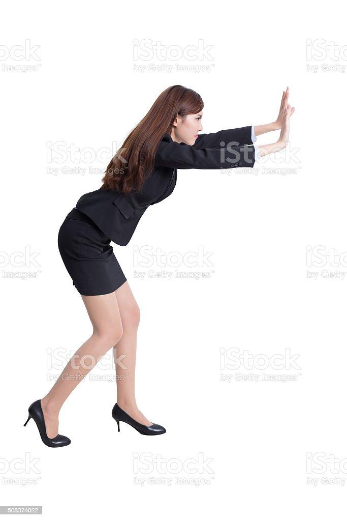 serious business woman push something stock photo