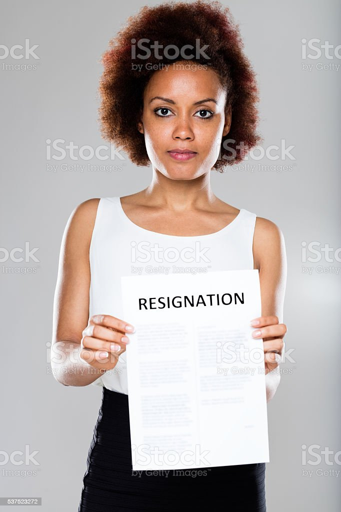 serious business woman showing resignation stock photo