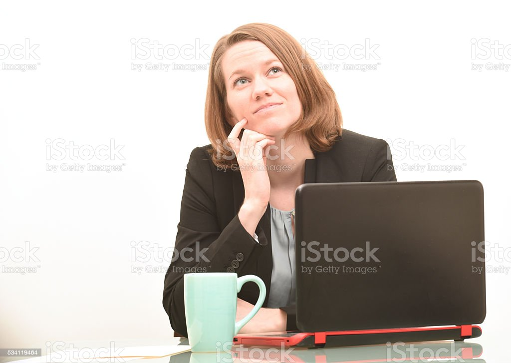 Serious business woman thinking or daydreaming stock photo