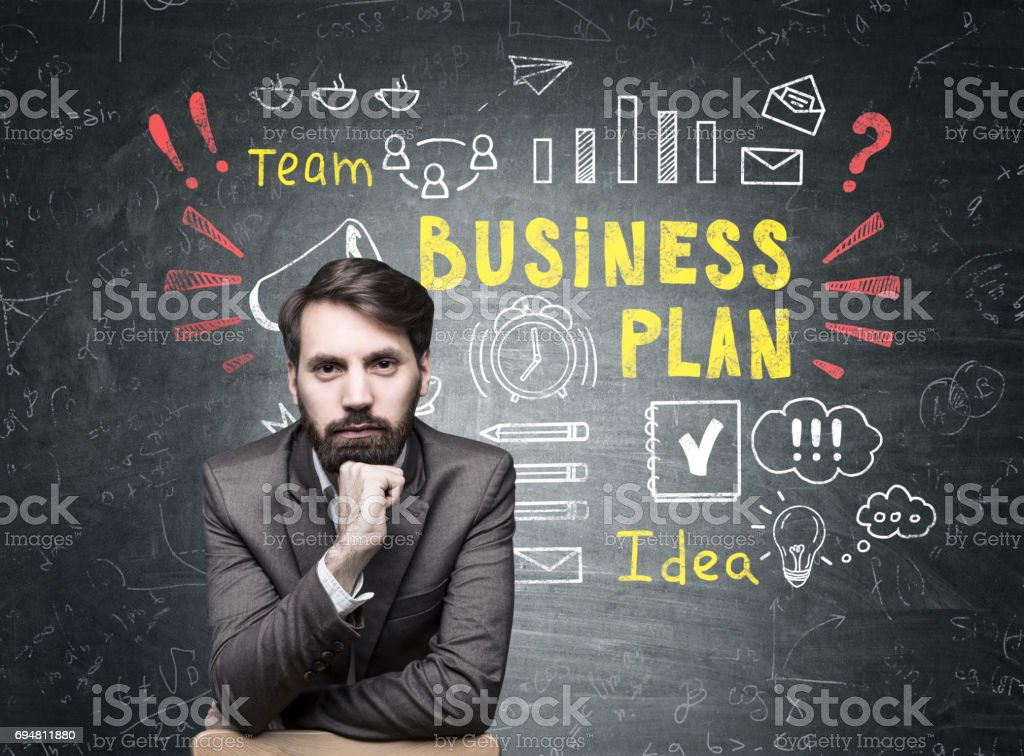 Serious businessman and good business plan stock photo