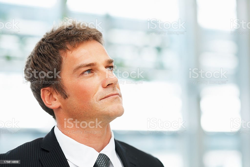 Serious businessman contemplating options stock photo