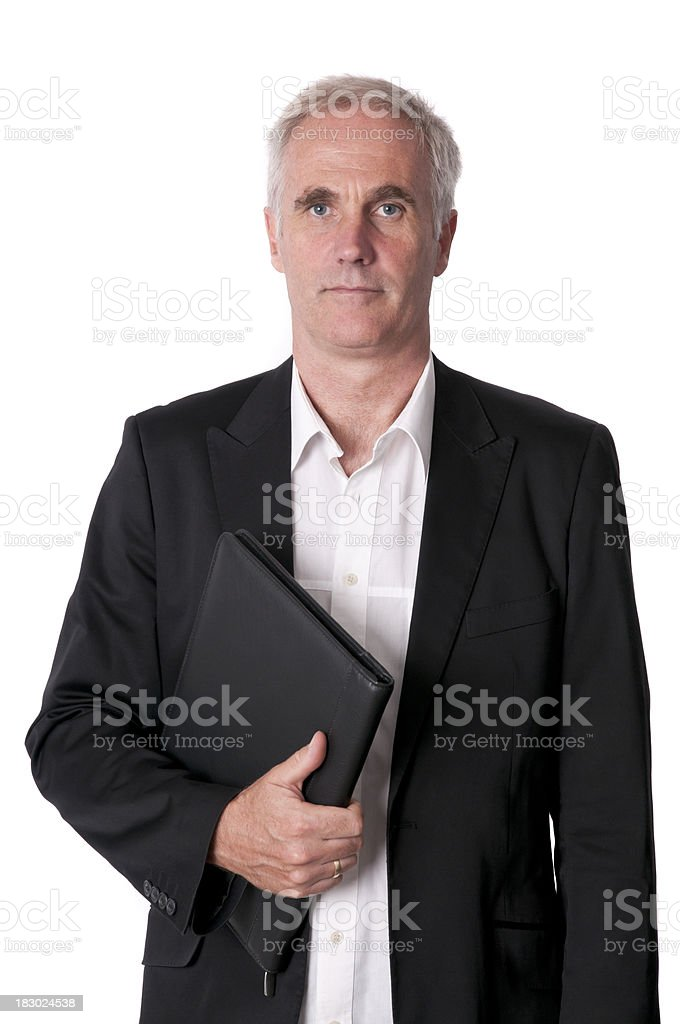 serious businessman holding a notebook royalty-free stock photo