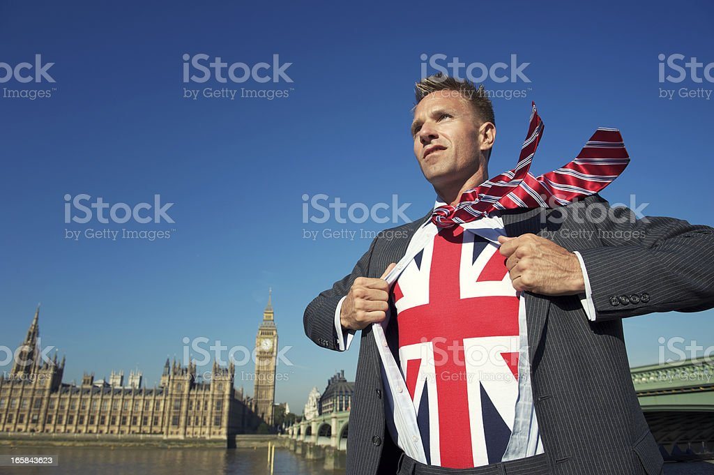 Serious Businessman in London Reveals Patriotic Superhero royalty-free stock photo