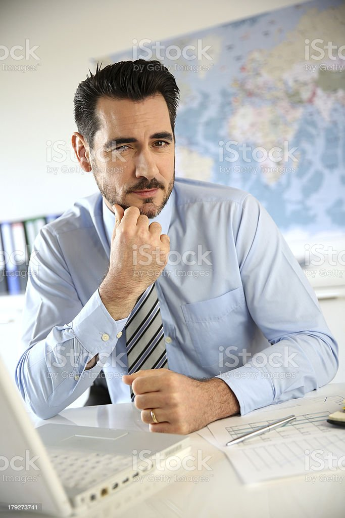 Serious businessman in office royalty-free stock photo