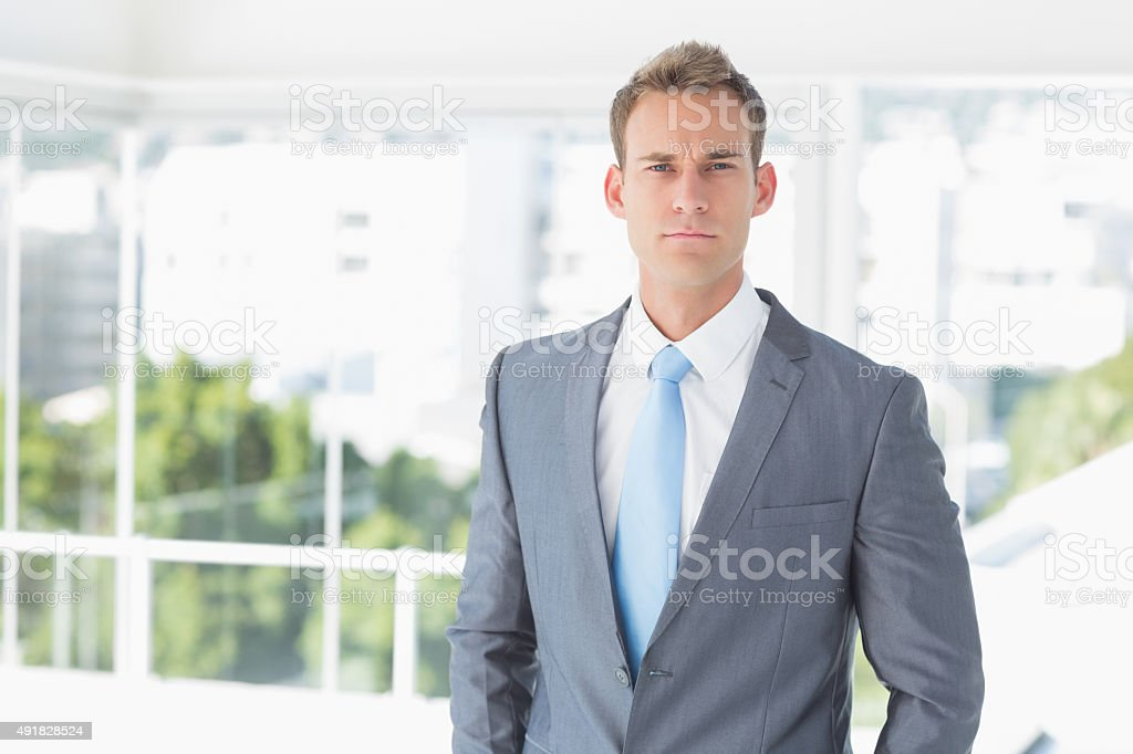 Serious businessman looking at camera stock photo