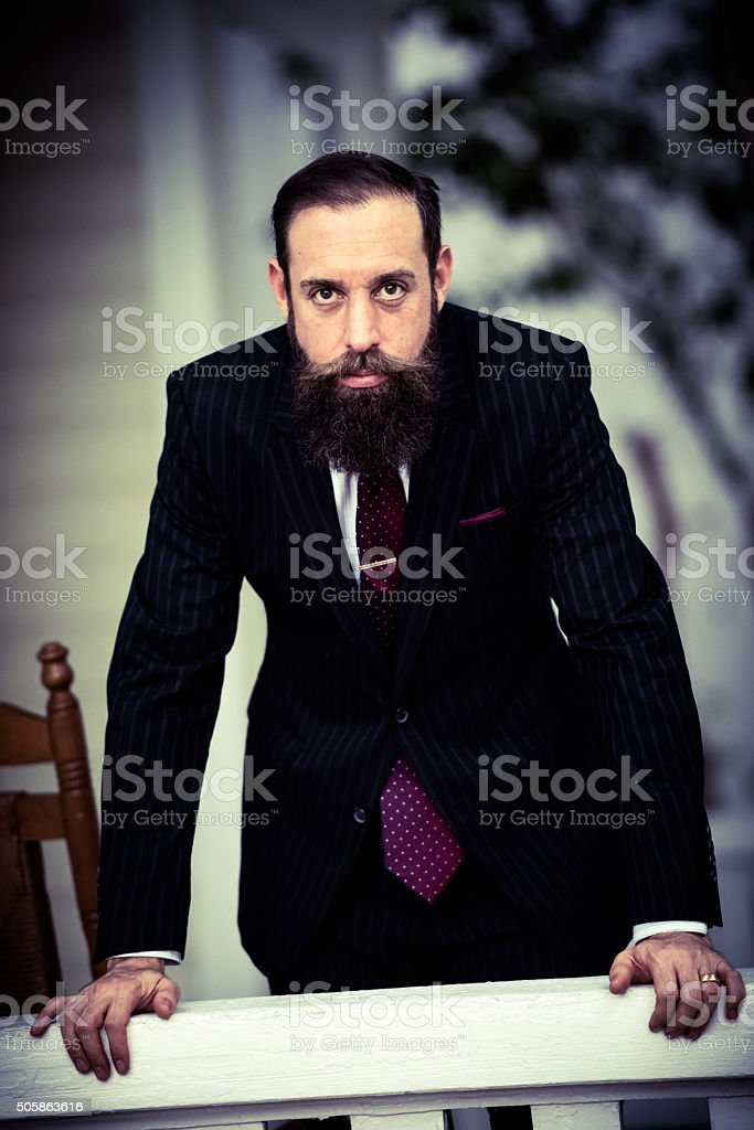 Serious businessman looking at the camera stock photo