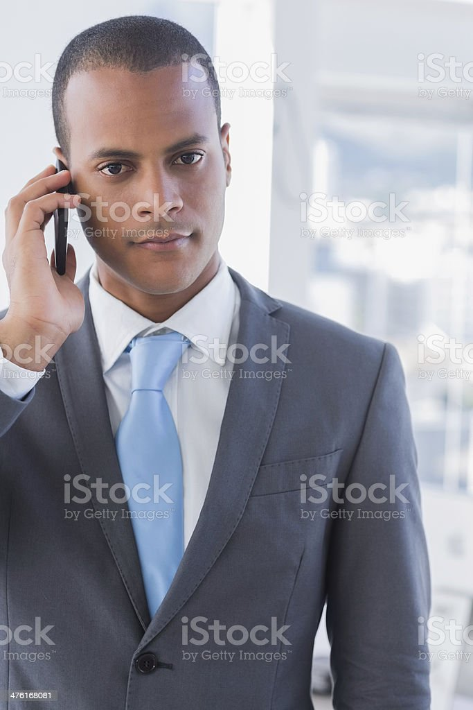 Serious businessman on a call royalty-free stock photo