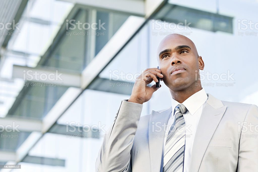 Serious Businessman on a Cellphone royalty-free stock photo