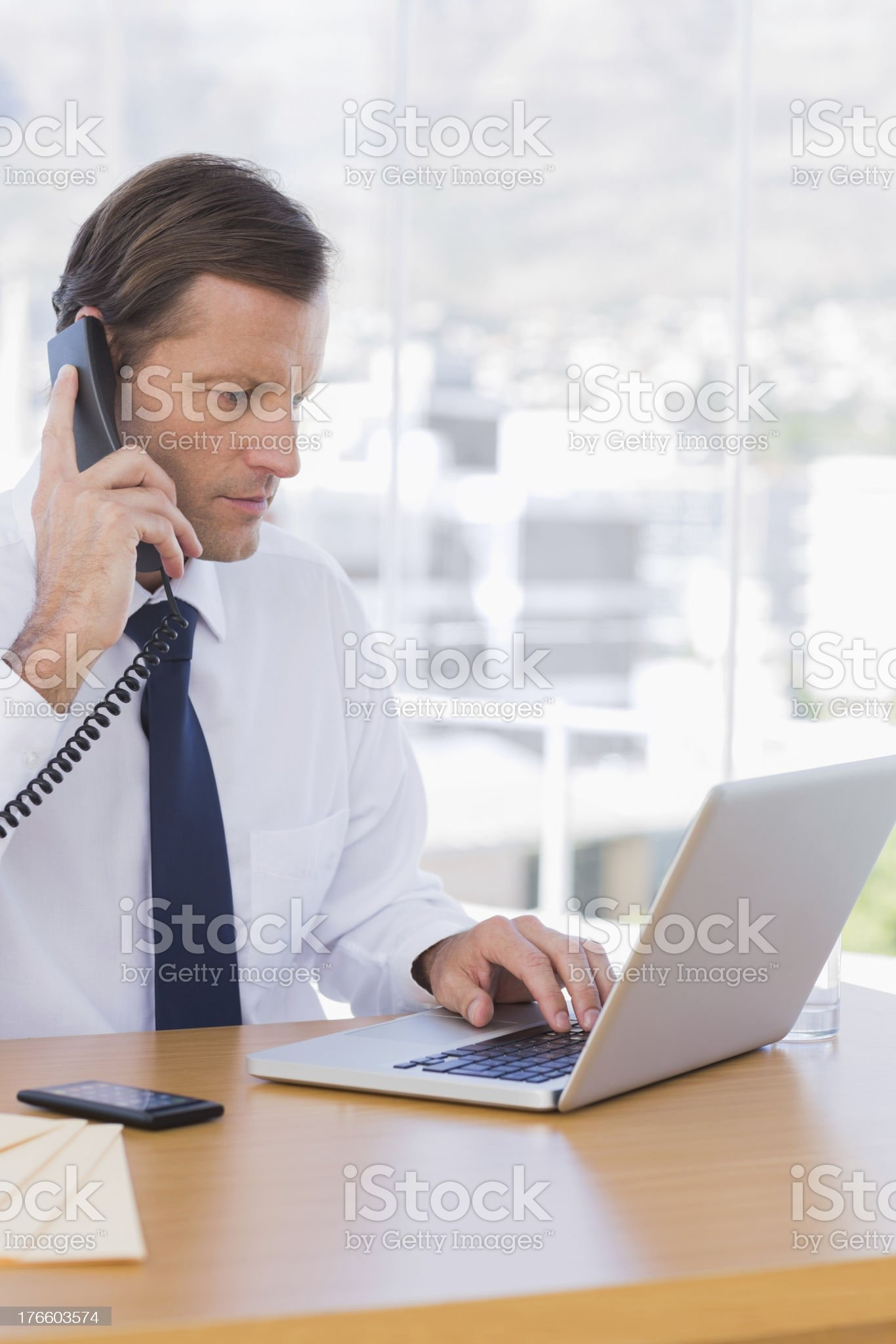 Serious businessman on the phone royalty-free stock photo