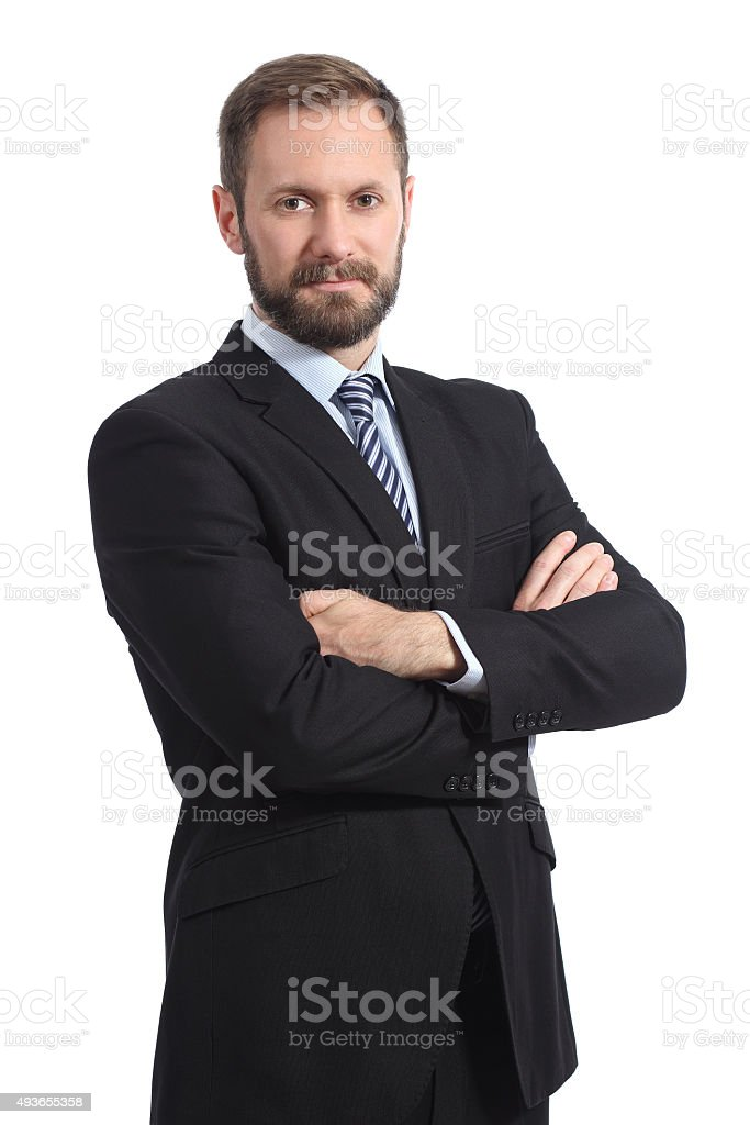 Serious businessman posing with folded arms stock photo