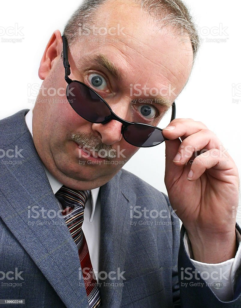 Serious Businessman Takes Sunglasses Off royalty-free stock photo
