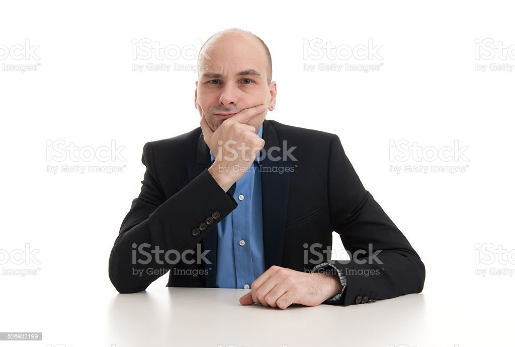 serious businessman thinking stock photo