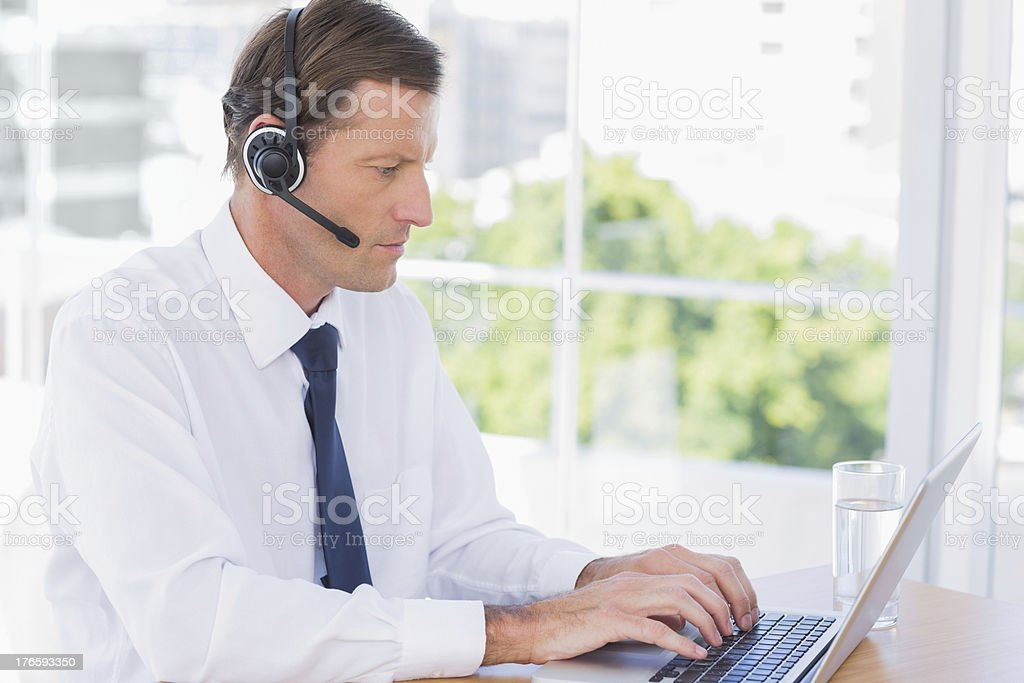 Serious businessman wearing a headset royalty-free stock photo