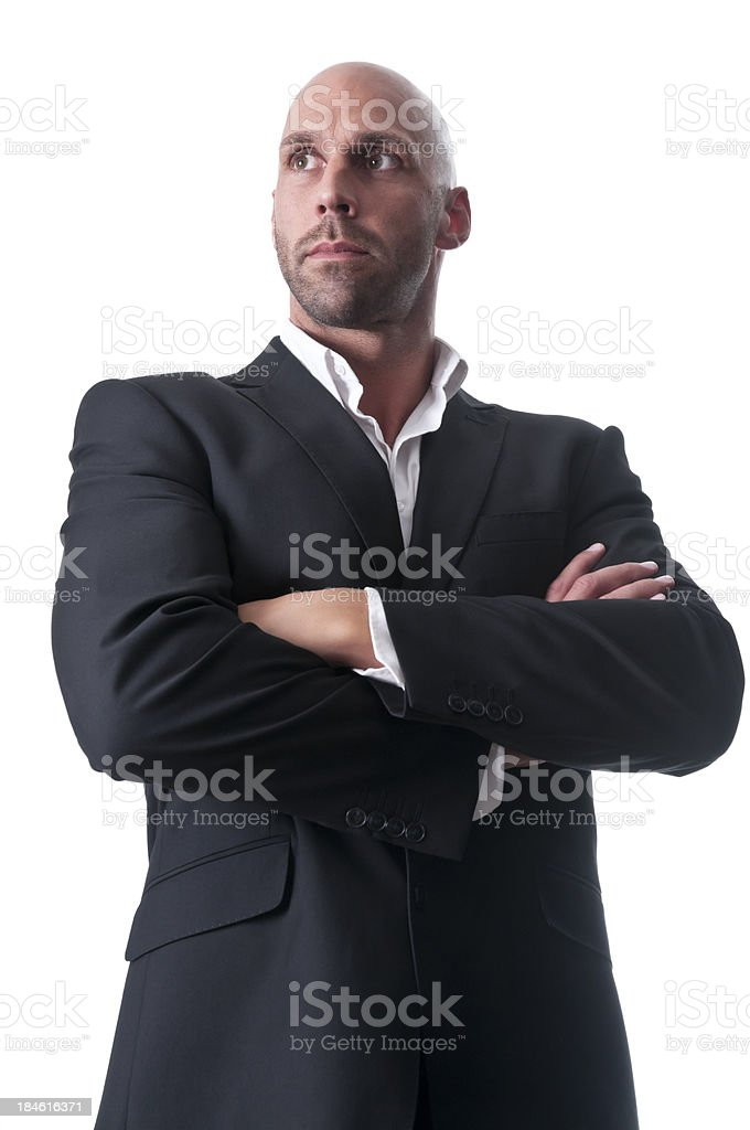 serious businessman with arms crossed royalty-free stock photo