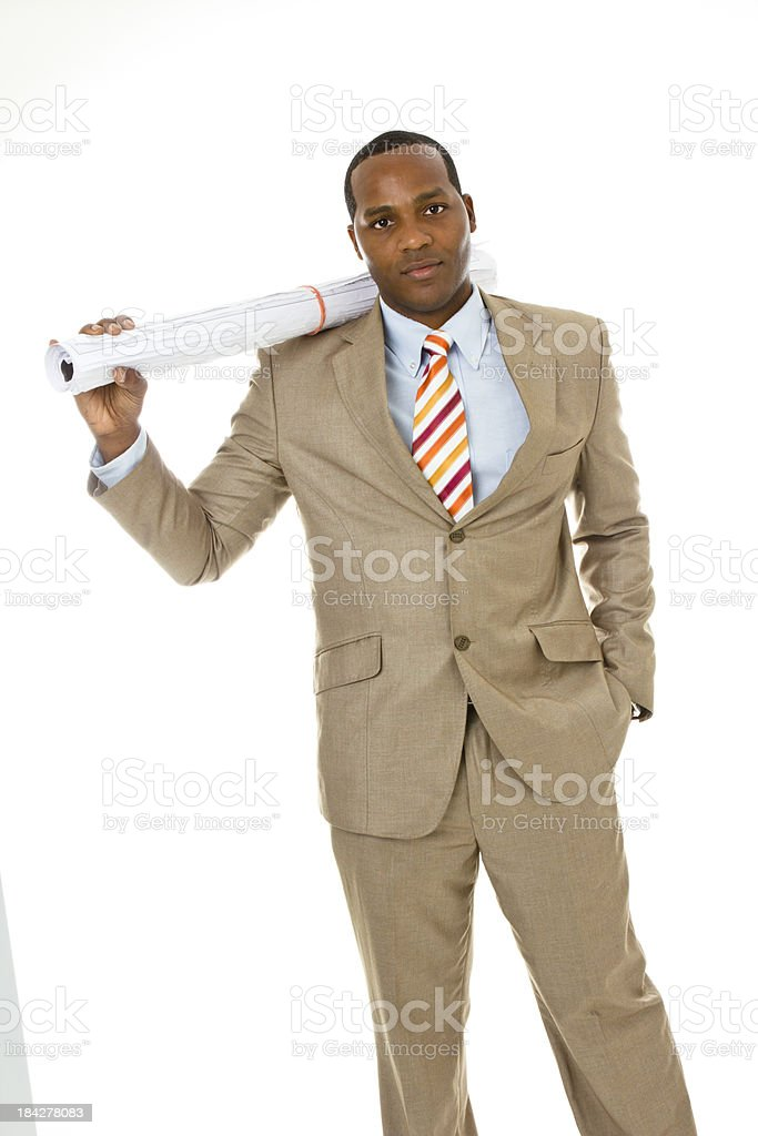 Serious businessman with blueprints stock photo