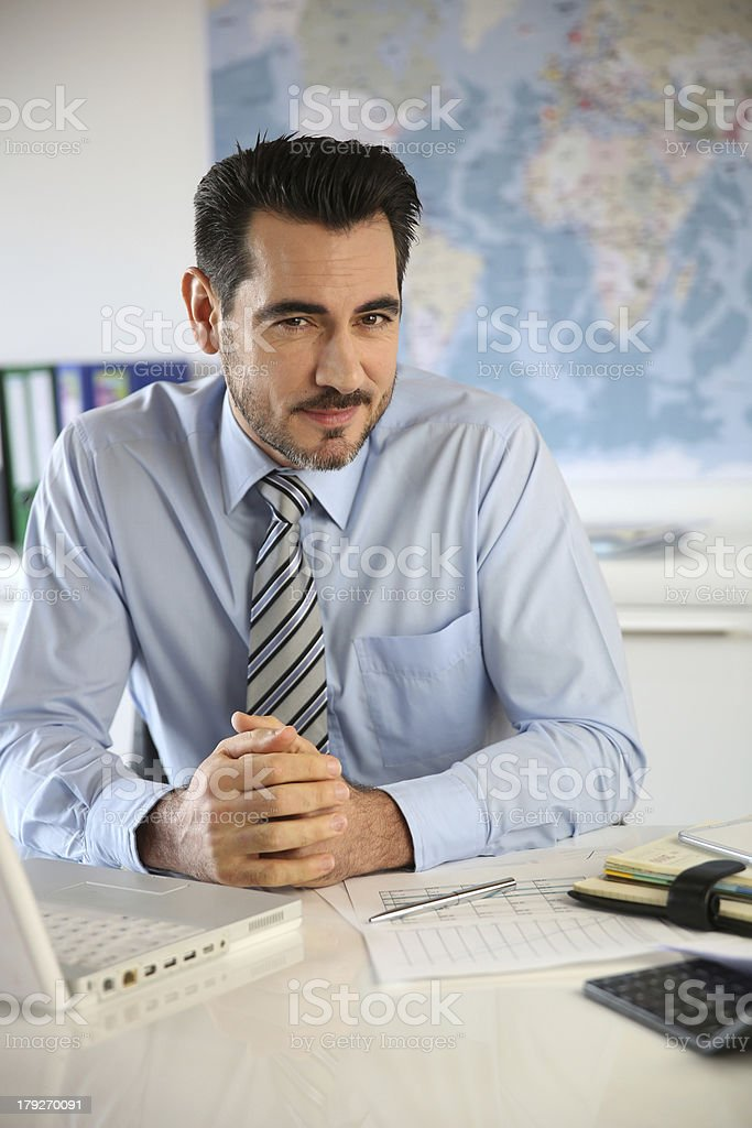 Serious businessman working with a laptop royalty-free stock photo