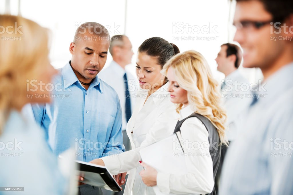 Serious businesspeople looking at reports. royalty-free stock photo