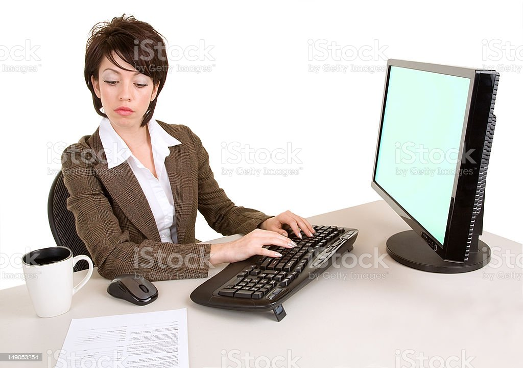 Serious Businesswoman Working at a Computer royalty-free stock photo
