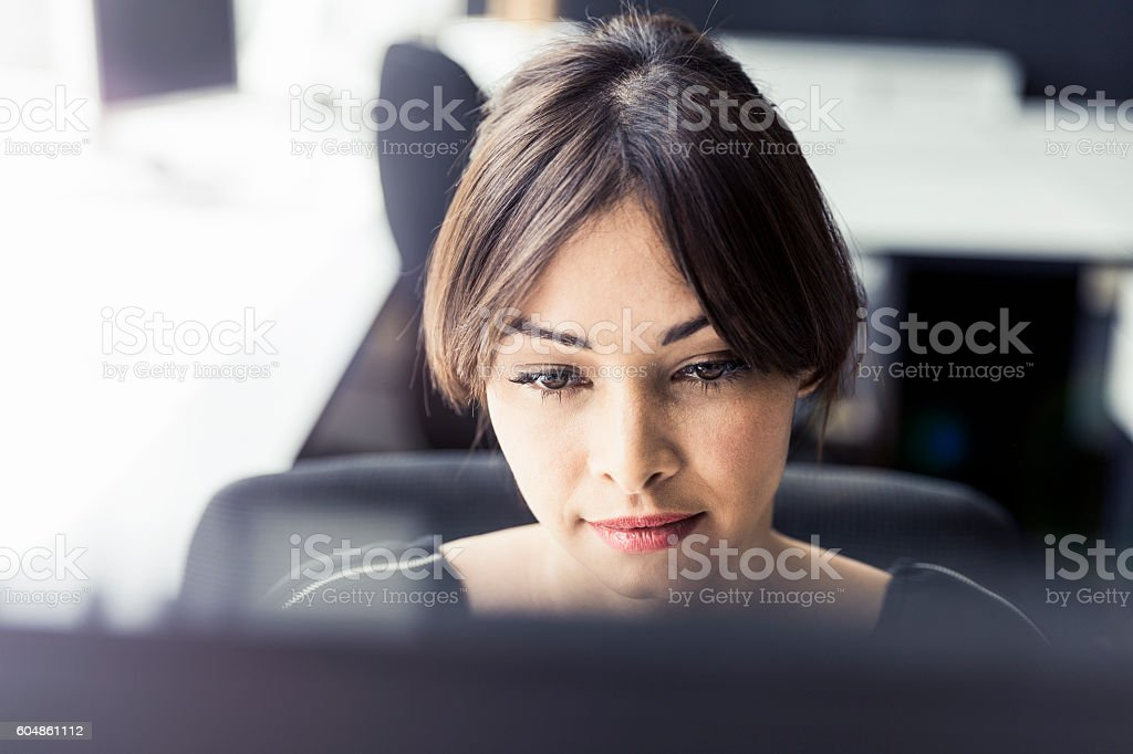 Serious businesswoman working at office stock photo