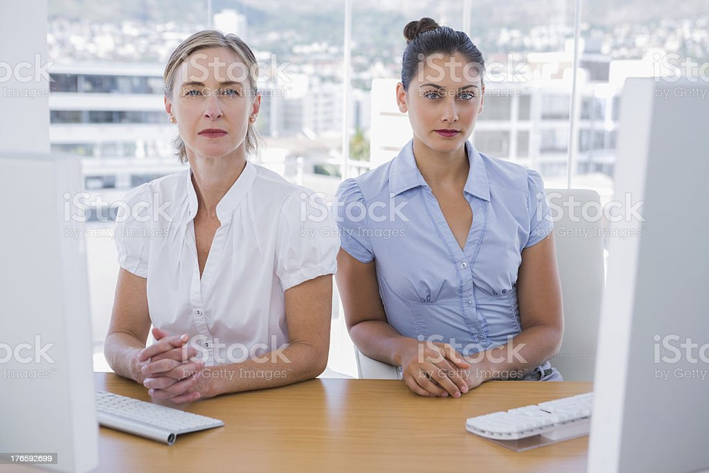 Serious businesswomen sitting together royalty-free stock photo