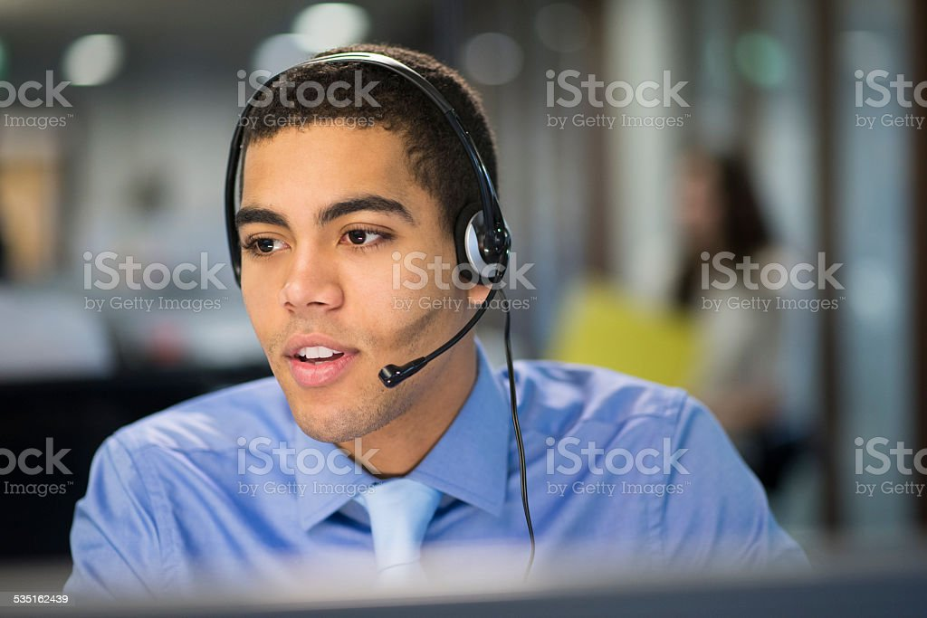 serious call centre rep stock photo