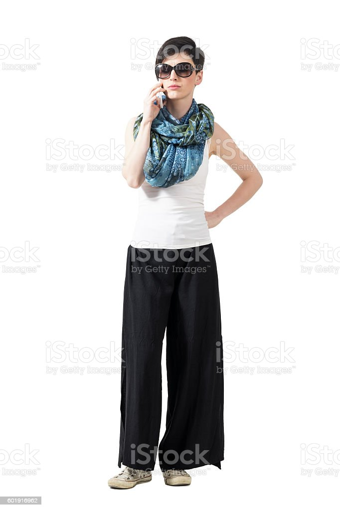 Serious casual pretty woman talking on the phone stock photo