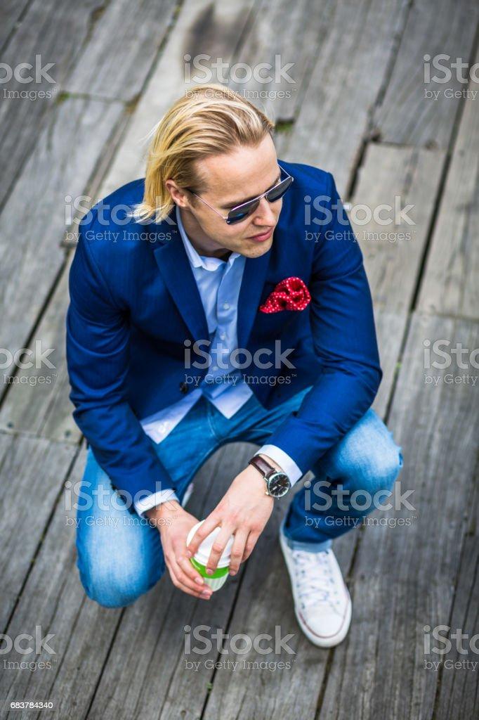Serious Caucasian Male Model Crouching stock photo