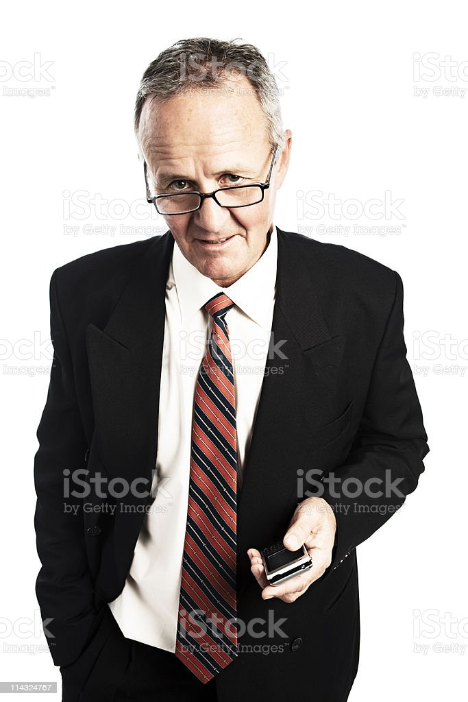 Serious CEO with cell phone royalty-free stock photo