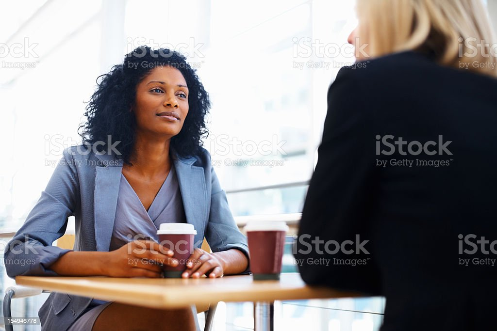 Serious chat over coffee break royalty-free stock photo