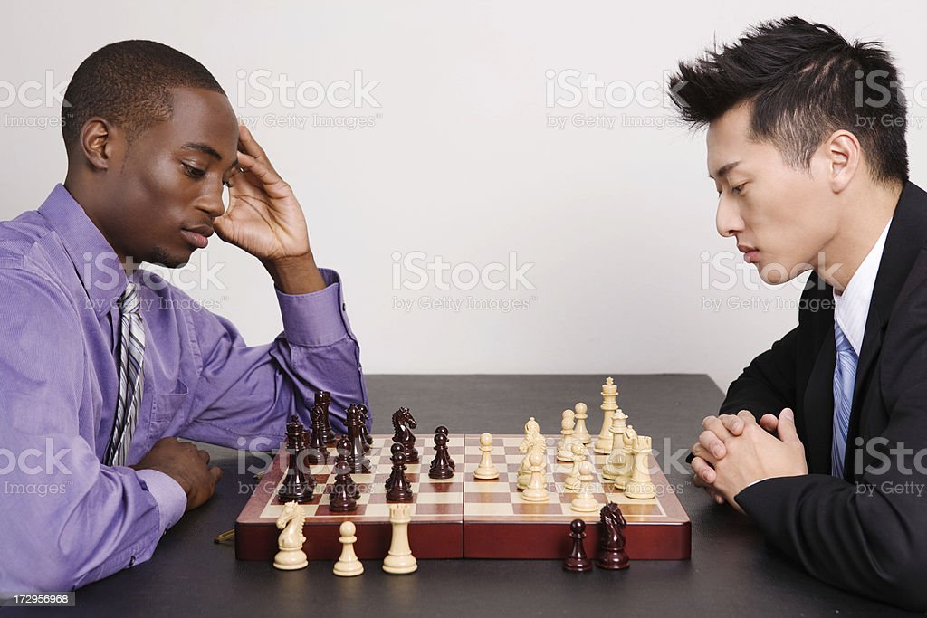 Serious chess players thinking about their next moves stock photo