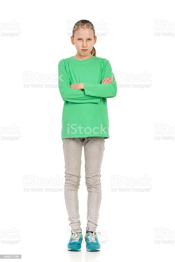 Serious Child Girl Standing With Arms Crossed stock photo