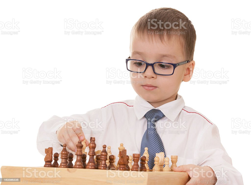 Serious child playing chess royalty-free stock photo