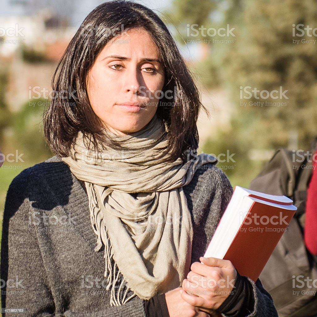 serious college student with book royalty-free stock photo