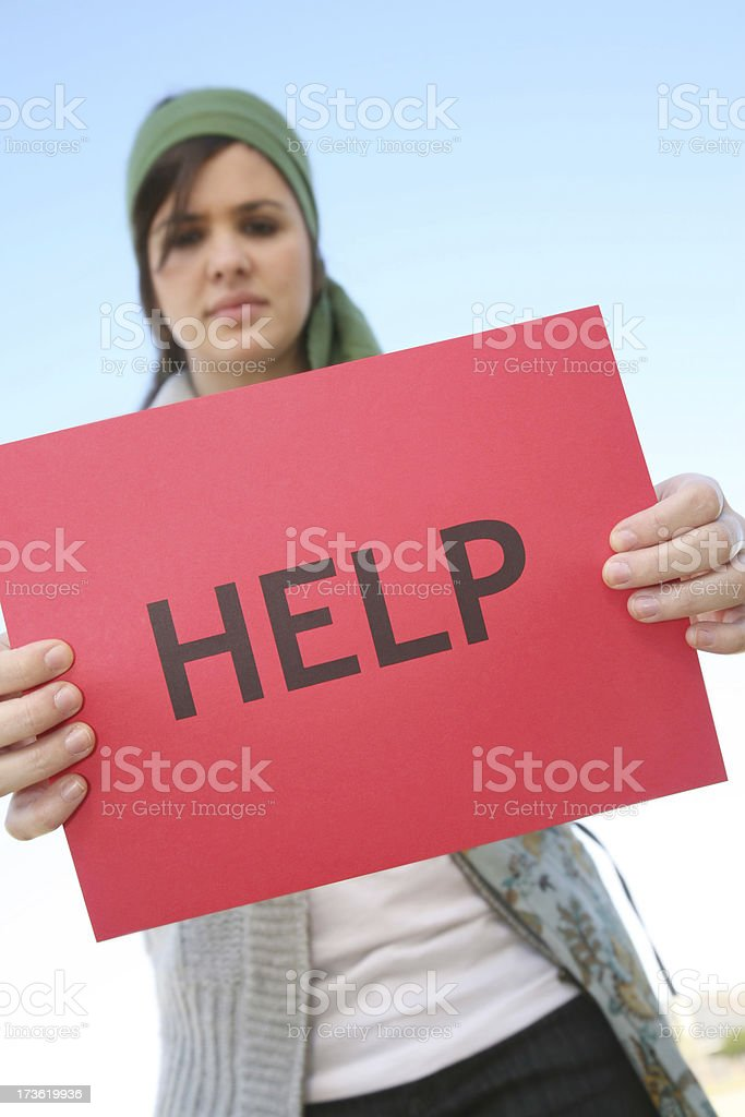 Serious Concerned Girl Holding A Help Sign royalty-free stock photo