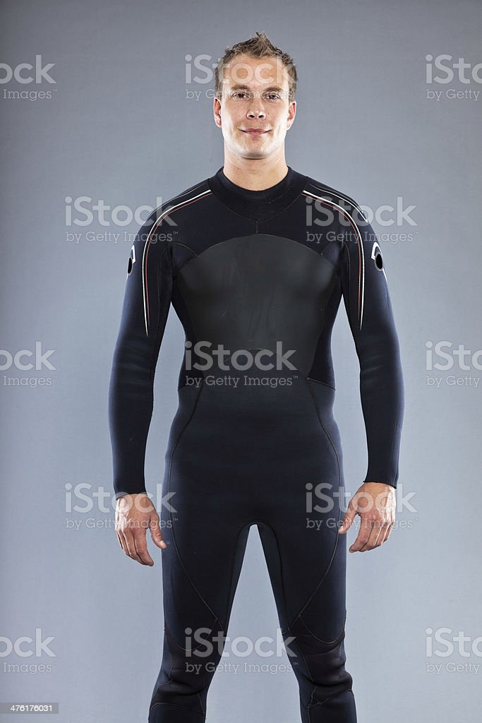 Serious confident man with short hair wearing wetsuit. Kite surfer. stock photo