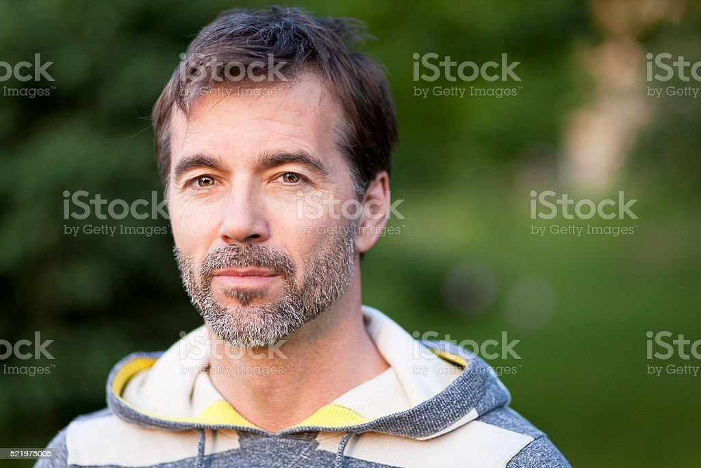 Serious Confident Mature Man Looking At The Camera stock photo