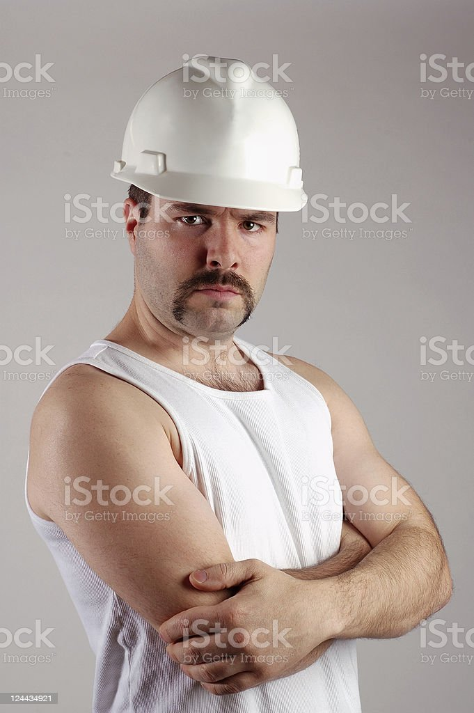 Serious Construction Worker in sleeveless shirt royalty-free stock photo