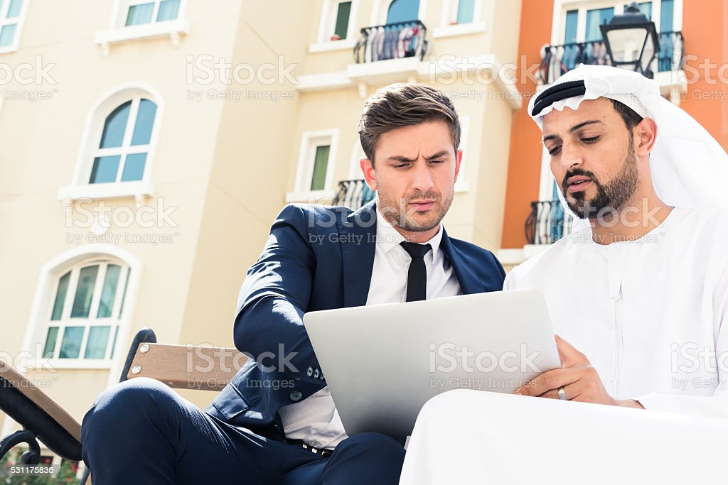 Serious Conversation over a large digital tablet stock photo