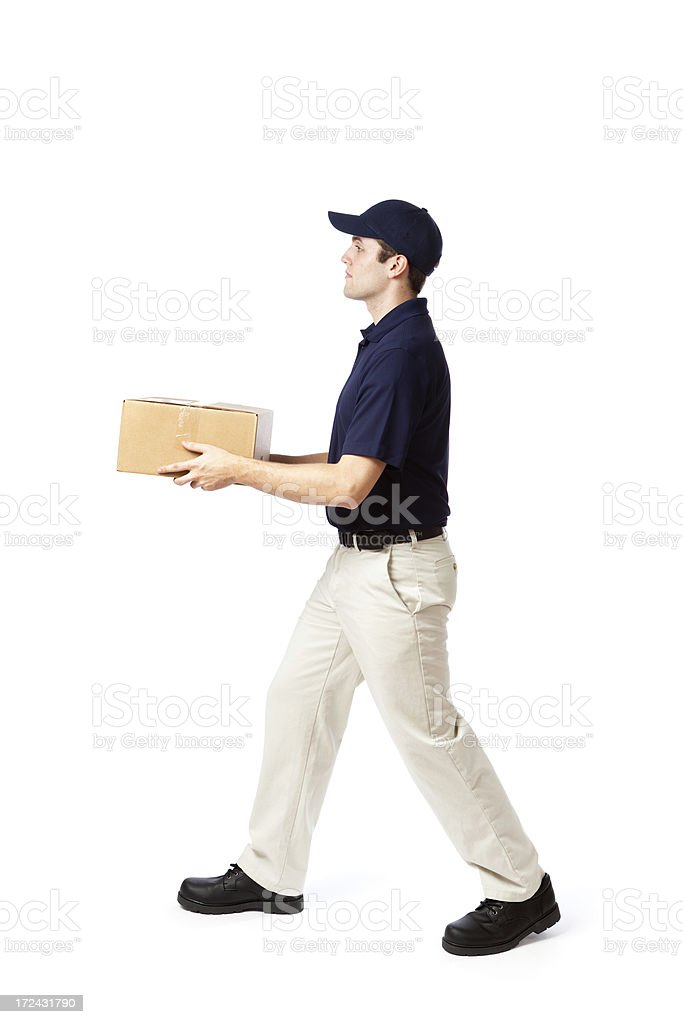 Serious Delivery Man in Action Delivering Package on White stock photo