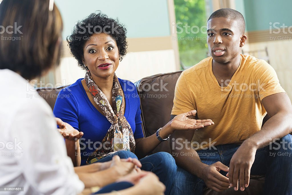 Serious discussion happening in a support group or Bible study stock photo