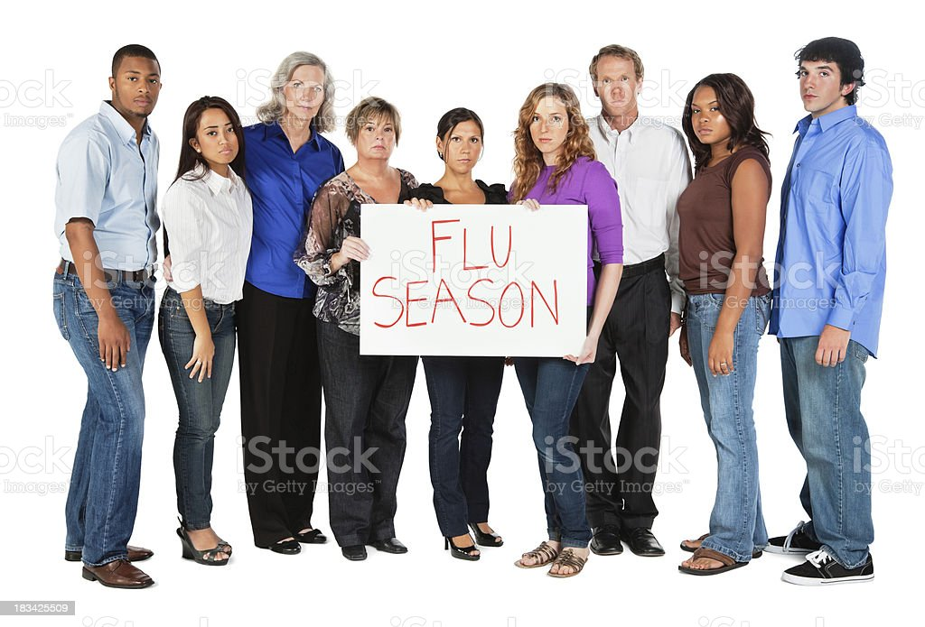 Serious Diverse Group of People Holding Flu Season Sign stock photo