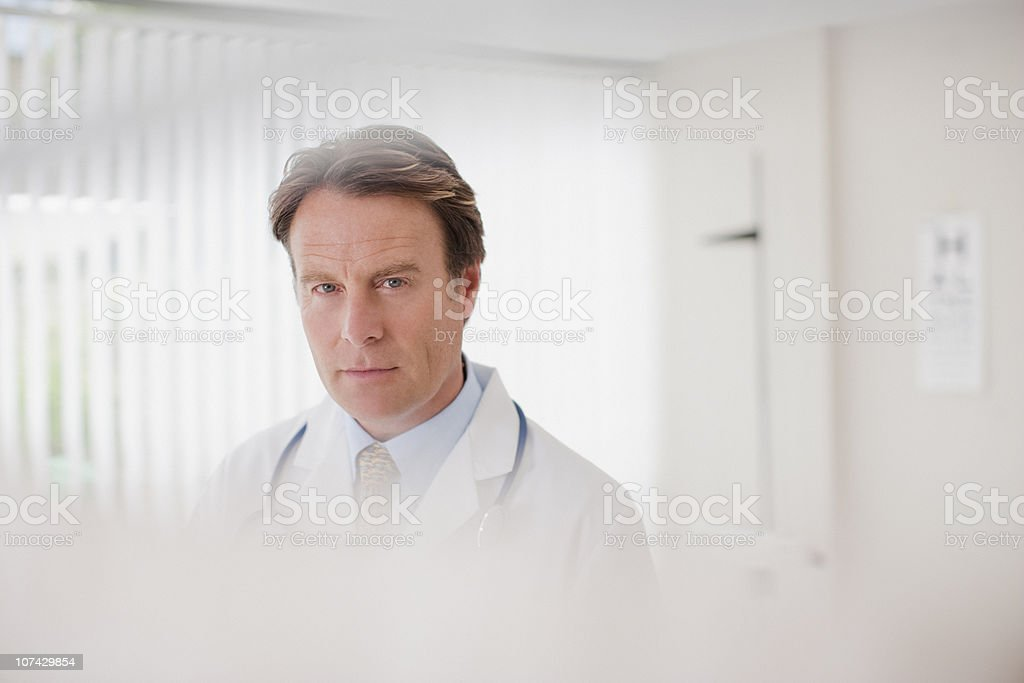 Serious doctor in doctors office royalty-free stock photo