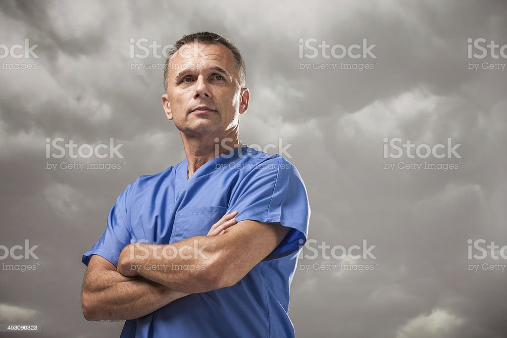 Serious Doctor with Ominous Cloudy Sky royalty-free stock photo