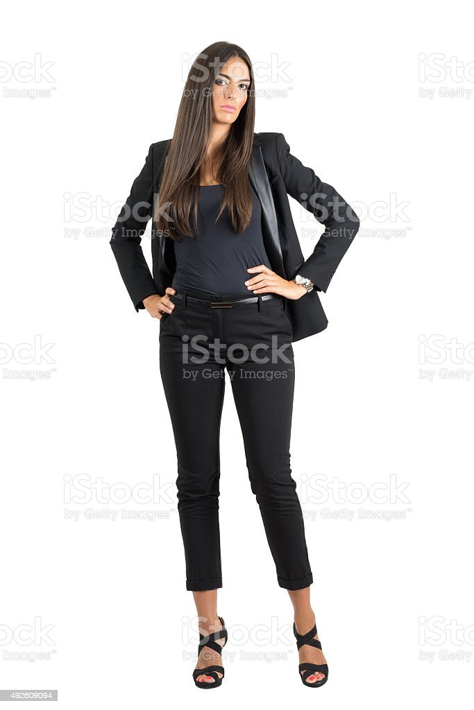 Serious elegant business woman with hands on her hips stock photo
